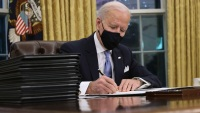 In First Days, Biden Flashes Action as Deep Problems Loom