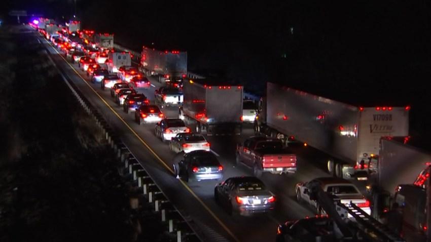 Cars line up bumper-to-bumper as police close a stretch of Interstate 95 in Northeast Philadelphia
