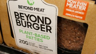 FILE - In this June 27, 2019, file photo, a meatless burger patty called Beyond Burger by Beyond Meat is displayed at a grocery store in Richmond, Va. Plant-based food company Beyond Meat will be partnering with several major fast food chains in the coming years to expand offerings that could eventually include plant-based burgers, chalupas or toppings on a stuffed-crust pizza. They announced on Thursday, Feb. 25, 2021, distribution agreements with McDonald's as well as with Yum Brands, the parent company of KFC, Taco Bell and Pizza Hut.
