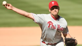 Jared Hughes throws a pitch in a Phillies uniform
