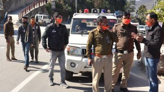 Police personnel prepare in Srinagar of Uttarakhand state on February 7, 2021 after a glacier broke off in Chamoli district causing flash floods in the Dhauli Ganga river.