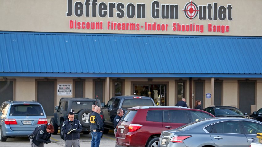 METAIRIE, LA - FEBRUARY 20: Investigators with the Jefferson Parish Sheriffs Office look at a shell casing in the parking lot of the Jefferson Gun Outlet as investigators work the scene on February 20, 2021 in Metairie, Louisiana. According to reports, three people were killed and two injured after an altercation lead to gunfire at an indoor shooting range.