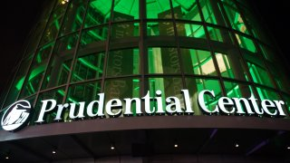 Prudential Center sign in front of green