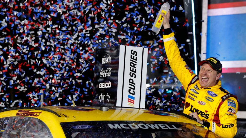 Michael McDowell, driver of the #34 Love's Travel Stops Ford, celebrates in victory lane after winning the NASCAR Cup Series 63rd Annual Daytona 500 at Daytona International Speedway on February 14, 2021 in Daytona Beach, Florida.