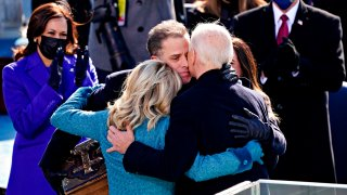 US President Joe Biden(R) is comforted by his son Hunter Biden and First Lady Jill Biden after being sworn in during the 59th presidential inauguration in Washington, DC on the West Front of the US Capitol on January 20, 2021 in Washington, DC.