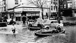 Flood waters in a city are seen in a photo from 1936