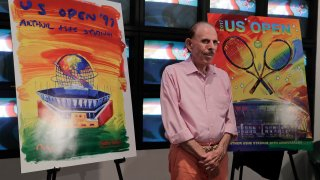 In this June 14, 2017, file photo, artist Peter Max poses for photos during the unveiling of the theme art he created for the 2017 U.S. Open tennis tournament in New York. Max also created the theme art first featuring Arthur Ashe Stadium when it was brand new 20 years ago.