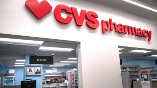 A pharmacist works at the CVS pharmacy at Target in the Tenleytown area of Washington, March 17, 2020.