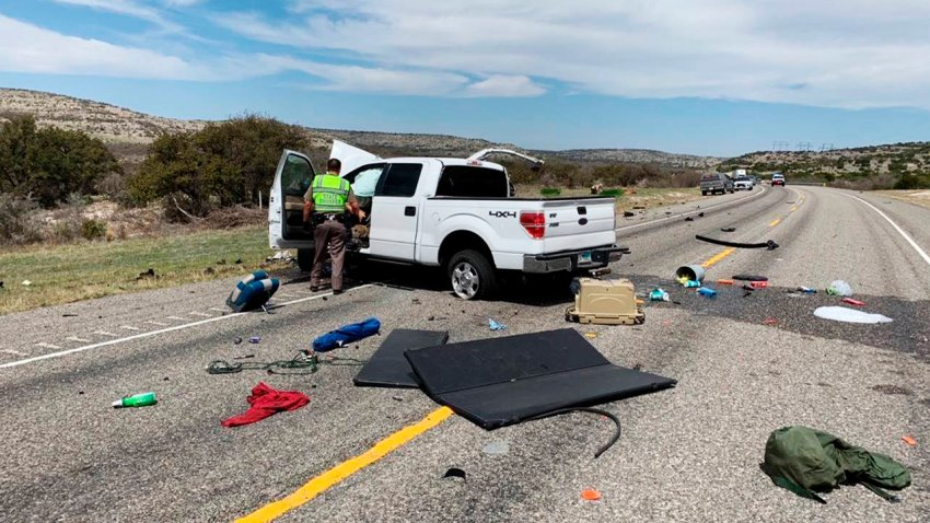 In this March 15, 2021, file photo, debris is strewn across a road near the border city of Del Rio, Texas after a collision. Eight people in a pickup truck loaded with immigrants were killed when the vehicle collided with an SUV following a police chase, authorities said.