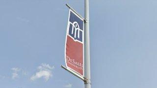 DeSales University flag on a pole