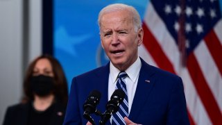 US President Joe Biden with Vice President Kamala Harris (L), delivers remarks on Covid-19 response and vaccinations in the South Court Auditorium of the White House in Washington DC, on March 29, 2021. - US President Joe Biden's administration on March 29, 2021 announced a set of new actions to ensure that 90 percent of adults will be eligible for vaccination against Covid by April 19.