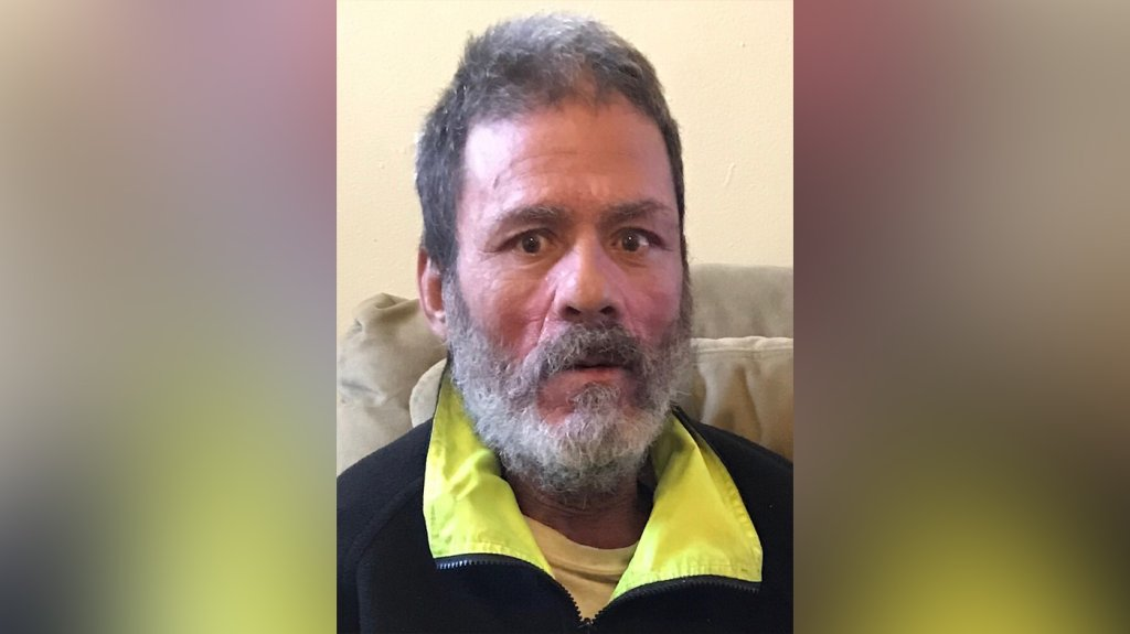 Roberto Oquendo Velez is seen in a black shirt with yellow collar
