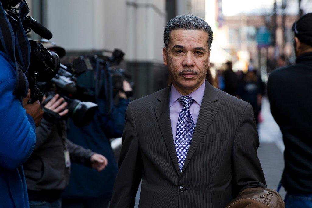 Philadelphia prosecutor Carlos Vega walks away from the criminal courthouse