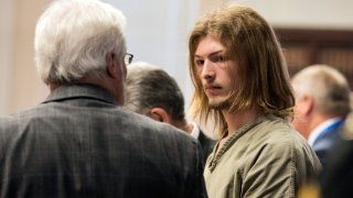 """Edward """"Jake"""" Wagner is arraigned at the Pike County Courthouse on Tuesday, Nov. 27, 2018 in Waverly, Ohio. The first of four family members charged with the 2016 shootings of seven adults and a teenager from the Rhoden family has pleaded not guilty to aggravated murder and other charges in the potential death penalty case. Wagner acknowledged the 23 counts against him but said little else. He is being held without bond."""