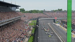 INDIANAPOLIS, IN - MAY 26: IndyCar driver Simon Pagenaud (22) of the Menards Team Penske Chevrolet leads the field tot he green flag for the start of the NTT IndyCar Series 103rd running of the Indianapolis 500 on May 26, 2019, at the Indianapolis Motor Speedway in Indianapolis, Indiana.