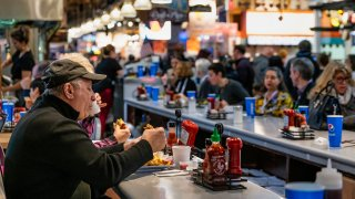 Diners eating lunch at the Reading Terminal Market in