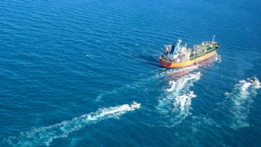 A picture obtained by AFP from the Iranian news agency Tasnim on January 4, 2021, shows the South Korean-flagged tanker being escorted by Iran's Revolutionary Guards navy after being seized in the Gulf. -