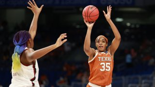 SAN ANTONIO, TX - MARCH 30: Charli Collier #35 of the Texas Longhorns shoots over Aliyah Boston #4 of the South Carolina Gamecocks in the Elite Eight round of the NCAA Women's Basketball Tournament at the Alamodome on March 30, 2021, in San Antonio, Texas.