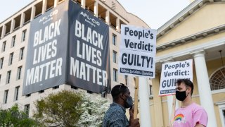 People carry signs after the verdict is announced in the trial of former Minneapolis police officer Derek Chauvin in Black Lives Matter Plaza in Washington, D.C., U.S., on April 20, 2021. Former Minneapolis police officer Derek Chauvin was found guilty of killingGeorge Floydwhen he knelt on the mans neck for 9 minutes and 29 seconds, a videotaped death that ignited a summer of rage and the greatest racial reckoning in the U.S. since the 1960s.