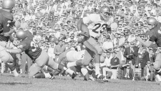 Purdue's Leroy Keyes carrying football in black and white photo