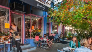 Patrons dine at tables outside Sabrina's Café in South Philadelphia