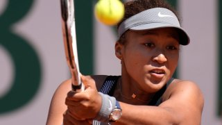 Japan's Naomi Osaka returns the ball to Romania's Patricia Maria Tig during their first round match of the French open tennis tournament