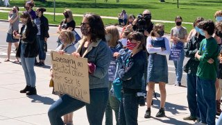 Supporters of a 19-year-old legislative intern rally outside the Idaho Statehouse