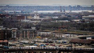 Sections of Newark and the Passaic River in New Jersey on April 10, 2018. Residents and environmental activists from Newark urged the Passaic Valley Sewerage Commission on Thursday, May 13, 2021, to scrap its plan for a backup power plant that would burn natural gas in favor of one using renewable energy, or at least a hybrid, less-polluting design.