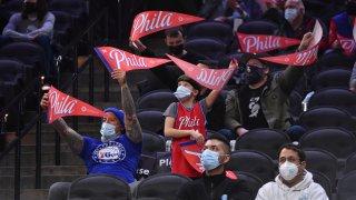 Philadelphia 76ers fans celebrate during a game on March 16, 2021 at Wells Fargo Center in Philadelphia, Pennsylvania.