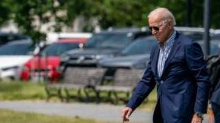 U.S. President Joe Biden walks on the Ellipse to board Marine One on May 22, 2021 in Washington, DC.