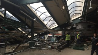 A NJ Transit train seen through the wreckage after it crashed in to the platform at the Hoboken Terminal September 29, 2016 in Hoboken, New Jersey