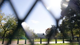 FILE - Fencing surrounds Lafayette Square in front of the White House in Washington, D.C., Nov. 2, 2020.