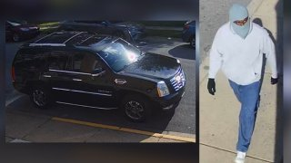 Left: a black Escalade Cadillac. Right: A man wearing a ski mask, gray hoodie and jeans.