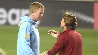 Atlanta coach Gabriel Heinze seems unhappy as he talks with Union coach Jim Curtin following the game.