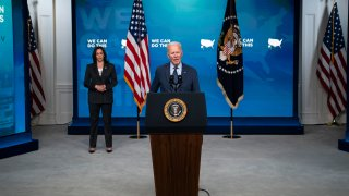 Vice President Kamala Harris listens as President Joe Biden speaks about the COVID-19 vaccination program, in the South Court Auditorium on the White House campus, Wednesday, June 2, 2021, in Washington.