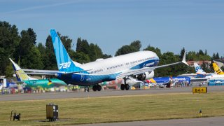 The final version of the 737 MAX, the MAX 10, passes other 737 MAX planes as it takes off from Renton Airport in Renton, Wash., on its first flight Friday, June 18, 2021. The plane will fly over Eastern Washington and then land at Boeing Field.