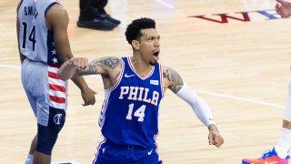 Philadelphia 76ers player Danny Green pumps his fist as he celebrates.