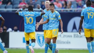 Philadelphia Union midfielder Quinn Sullivan (33) celebrates with teammates after scoring a goal in game action during a game between the Chicago Fire and the Philadelphia Union