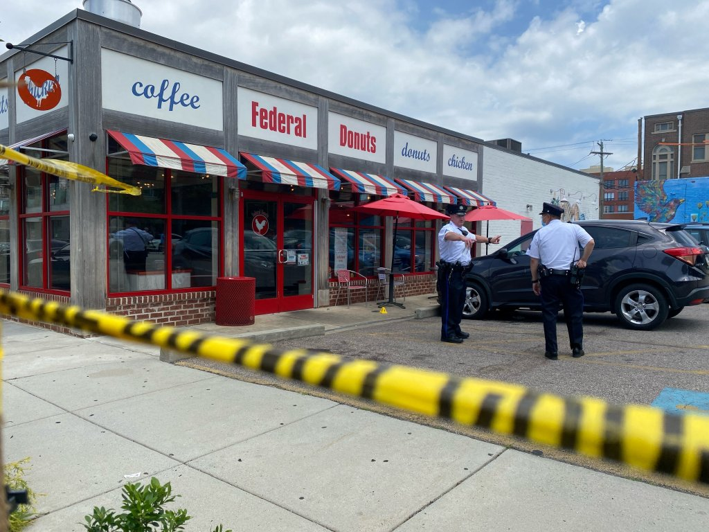 Philadelphia police officers outside the roped off Federal Donuts location