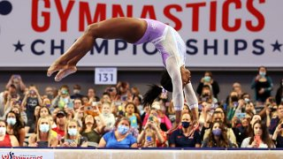 Simone Biles #227 competes on the beam during the Senior Women's competition of the 2021 U.S. Gymnastics Championships at Dickies Arena on June 4, 2021 in Fort Worth, Texas.