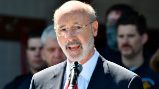Gov. Tom Wolf speaks at an event in Mechanicsburg, Pennsylvania, May 12, 2021. Beyond the local races on ballots, Pennsylvania's primary election will determine the future of a governor's authority during disaster declarations.