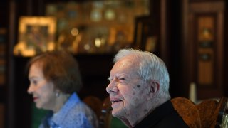 Former President of the United States, Jimmy Carter sits next to his wife, former First Lady, Rosalynn Carter while having dinner at the home of friend, Jill Stuckey and being interviewed by reporters on Saturday August 04, 2018 in Plains, GA.