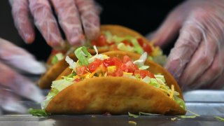 Tacos being made.