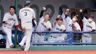 Japan celebrates a 3-2 walk-off victory against the Dominican Republic in the opening game of the Tokyo Olympics baseball tournament.