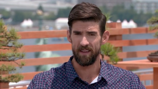 Michael Phelps speaks to NBC's Mike Tirico about Simone Biles and mental health on Tuesday, July 27, 2021.