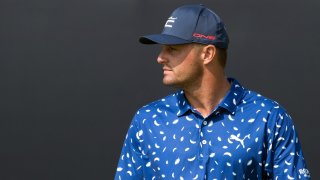 Jul 13, 2021; Sandwich, England, GBR; Bryson DeChambeau looks over the 18th green during a practice round for the Open Championship golf tournament at Royal St. George's Golf Course.