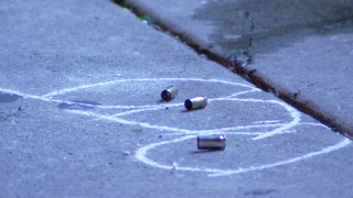 Three spent shell casings are circled by chalk as they lay on the street following a shooting in Philadelphia.