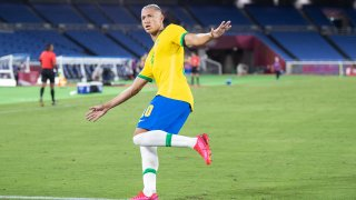 Richarlison of Brazil celebrates after scoring his team's second goal in the Men's First Round Group D match between Brazil and Germany.