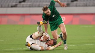 Stephen Tomasin grimaces as he scores against Ireland