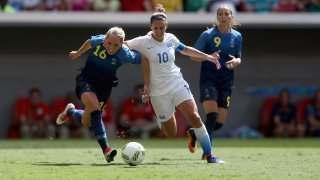 Carli Lloyd of United States battles for the ball against Elin Rubensson of Sweden during a soccer quarterfinal match of the Rio 2016 Olympic Games